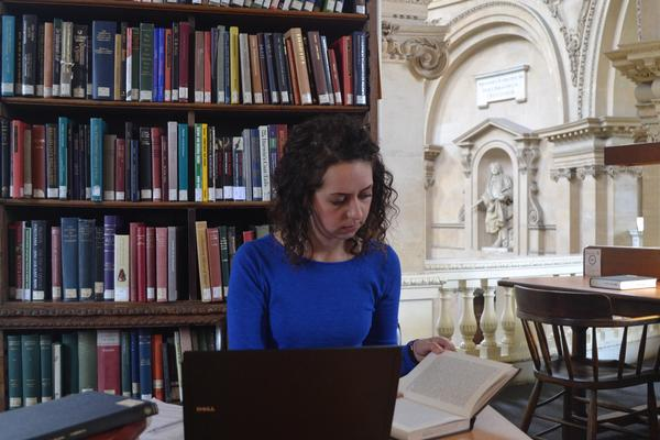 Graduate Student Studying in the Library