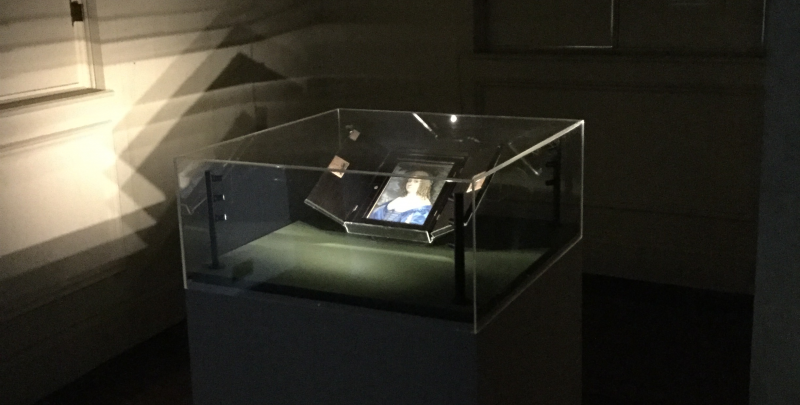 The glass case containing a portrait of Katherine Murray at Ham House, Richmond