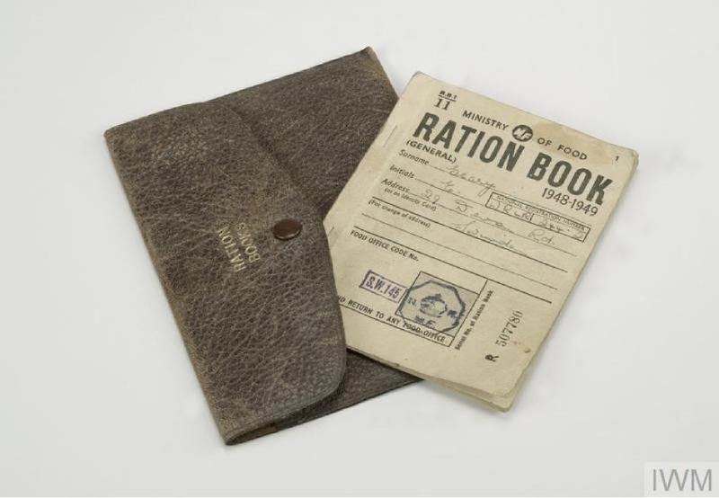 Image of a ration book commissioned by the UK Ministry of Food for the years 1948-49. It has yellowing pages and a leather pouch to be kept in.