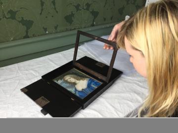 Dr Turnbull examining the Hoskins portrait