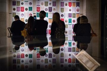 Visitors viewing the modern suffrage wall. This display of modern suffrage champions mirrored the exhibition's postcard display of the original suffragists, encouraging visitors to reflect on continuity and change.