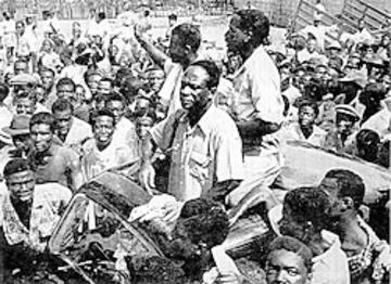 Photograph of Kwame Nkrumah being welcomed by crowds as he is released from prison in Ghana, dated 6 March 1957.