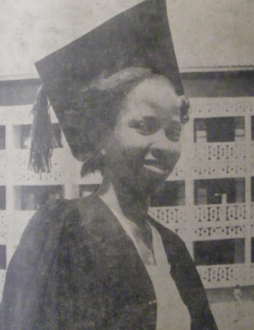 A student at the new university in 1952. The gown and hat that she is wearing is the same as those worn by British university students at the time.